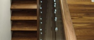 Square walnut handrail to glass staircase