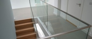 Frameless glass balustrade to complete the corbellian staircase
