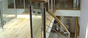 curved stairs with stainless steel & glass railing