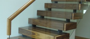 Equilibrium open stairs with frameless glass balustrade
