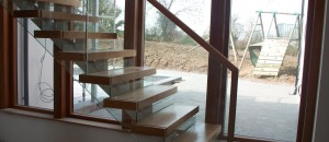 Contemporary stairs with frameless glass balustrade
